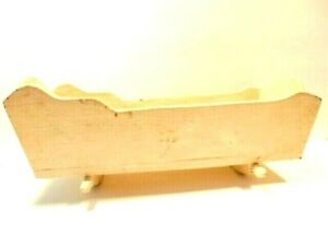 Vintage 16 inch  heavy wooden doll rocking cradle with flower decal on headboard