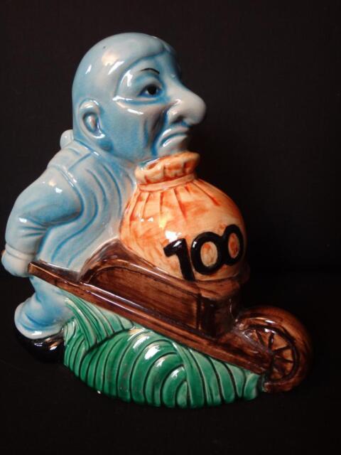 Originale tirelire en céramique homme à la brouette moneybox ceramic