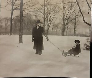 Vintage 1910's Photo of Man Wearing Long Leather Gloves Smokes Pipe Pulls Sled