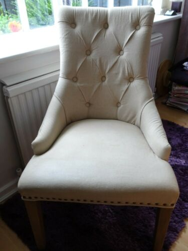 CREAM FABRIC FRENCH STYLE CAFE CHAIR, BUTTONED AND STUDDED WITH WRITING ON BACK