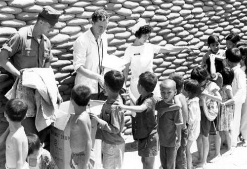 Vietnam Photo Americans Distributing Clothing to Children 1968