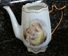 """Small decorative pitcher with picture of Virgin Mary and Baby Jesus.  3.2"""" tall."""