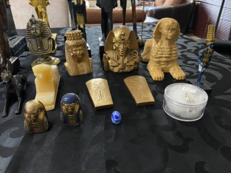 Egyptian statues , artifacts and replicas