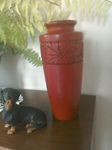 Reproduction Japanese Cinnabar vase with chrysanthemum pattern carved into the s