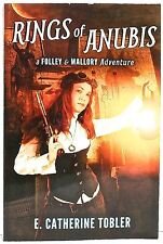 Rings of Anubis: A Folley & Mallory Adv. by E. CATHERINE TOBLER Masque Books2014