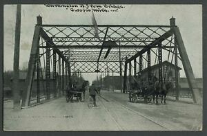 Owosso-MI-c-1910-Postcard-WASHINGTON-STREET-FROM-BRIDGE-over-Shiawassee