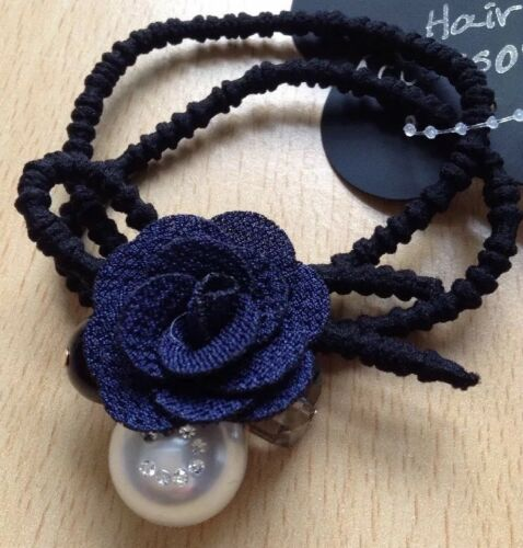 A Pretty Navy Flower Hair Bobble With Pearl Black And Crystal Beads