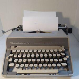 Remington Quiet-Riter Eleven Manual Typewriter w/ cover. It works!