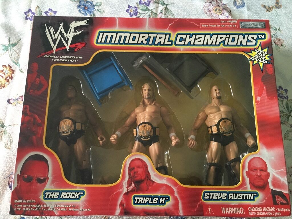 WWE WWF immortal champions Jakks figures Austin rock triple h