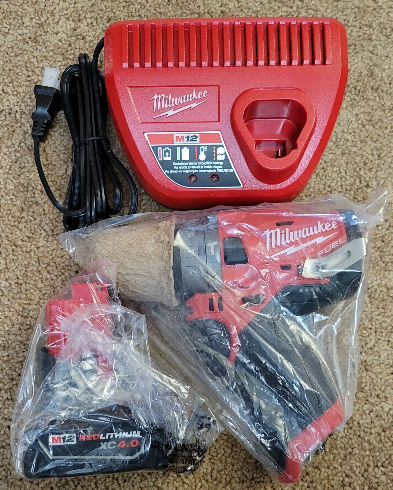 New Milwaukee M12 Hammer Drill Driver 2504-20 + 4.0Ah Battery Charger Kit. Buy it now for 129.87