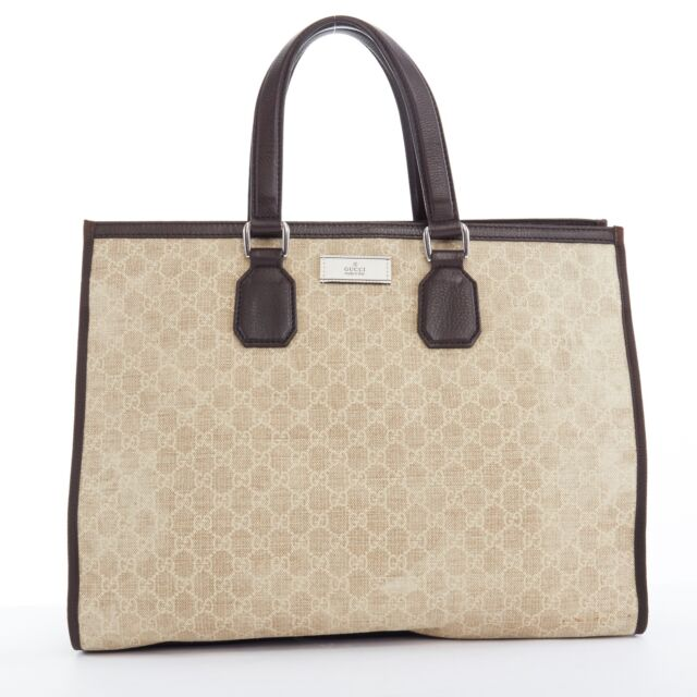 c78bc46272 GUCCI beige GG monogram canvas dark brown leather top handle tote bag