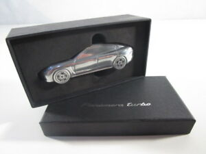 PORSCHE-PANAMERA-TURBO-LIMITED-EDITION-PISAPAPELES-METAL-SILVER-1-43