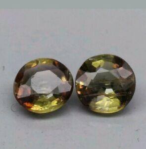 Andalucita-par-2-un-0-54-ct-4-mm-vvs-redondo-natural-marron-verde-amarillento