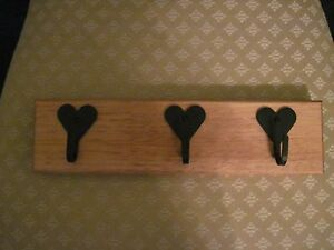 wooden key holder with 3 wrought iron black hearts