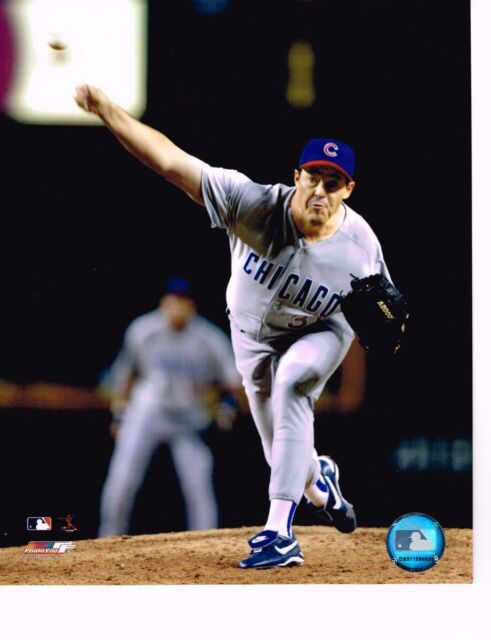 """Greg Maddux (Cubs) """"Action Pitching"""" #2 unsigned color 8x10 photo"""