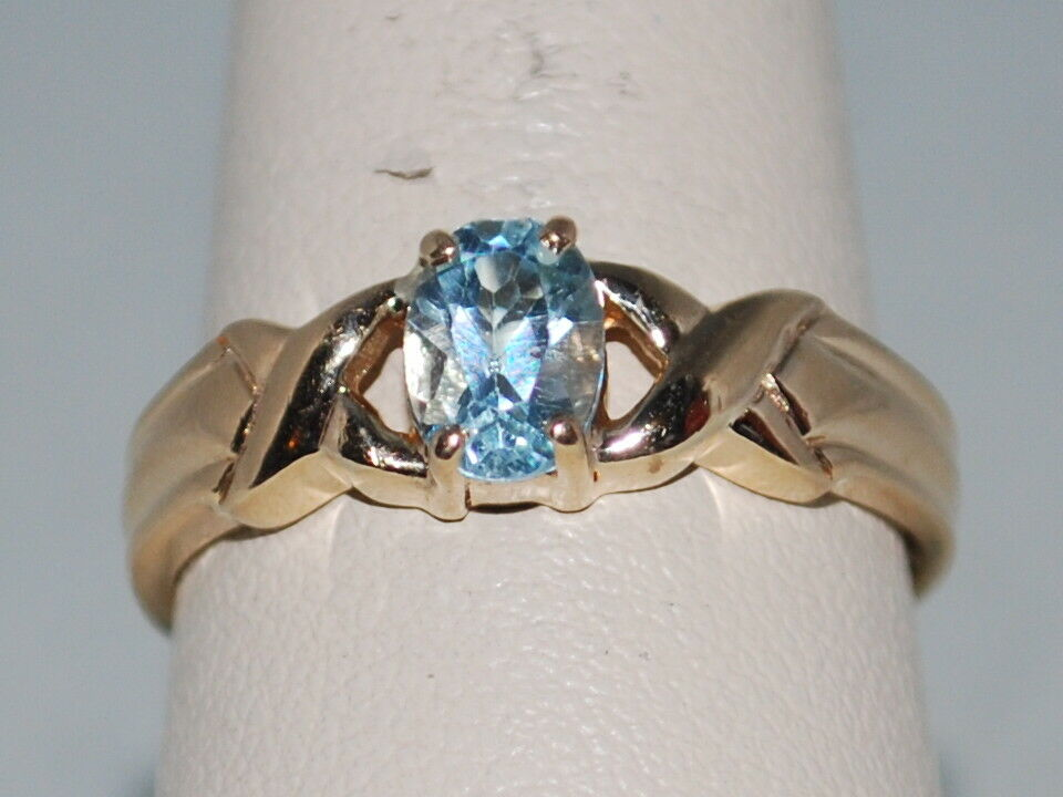 14k gold ring with a bluee Topaz(December birthstone) and a beautiful design