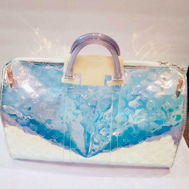 5e94a5897bf Louis Vuitton Keepall Bandouliere 50 Transparent embossed Monogram PVC  Iridescent Prism
