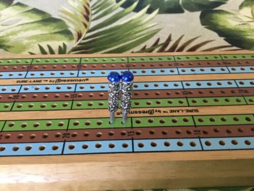 mottled cribbage pegs with royal blue half-round