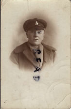 WW1 soldier Sussex Regiment wears Crusher Cap Greatcoat and woollen scarf