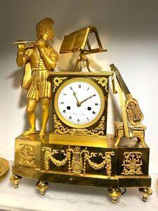 Pendule-troubadour-Bronze-dore-Epoque-Empire-debut-XIXe
