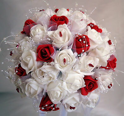 Brides,Bridesmaids,Flowergirl wedding bouquets/Flowers..Red. Lots of bling