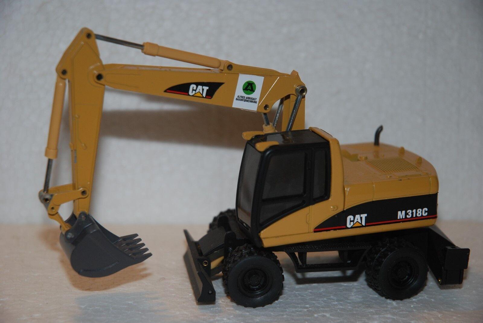1 50 NZG Escavatore gommato Cat M318 C