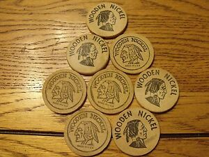 """8 WOODEN NICKELS FROM """"MOUNTAIN WOODCARVERS"""" 2 DIFFERENT TYPES 30+ YEARS OLD"""