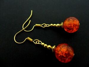 A PAIR  GOLD TONE  ORANGE CRACKLE GLASS BEAD DANGLY EARRINGS.