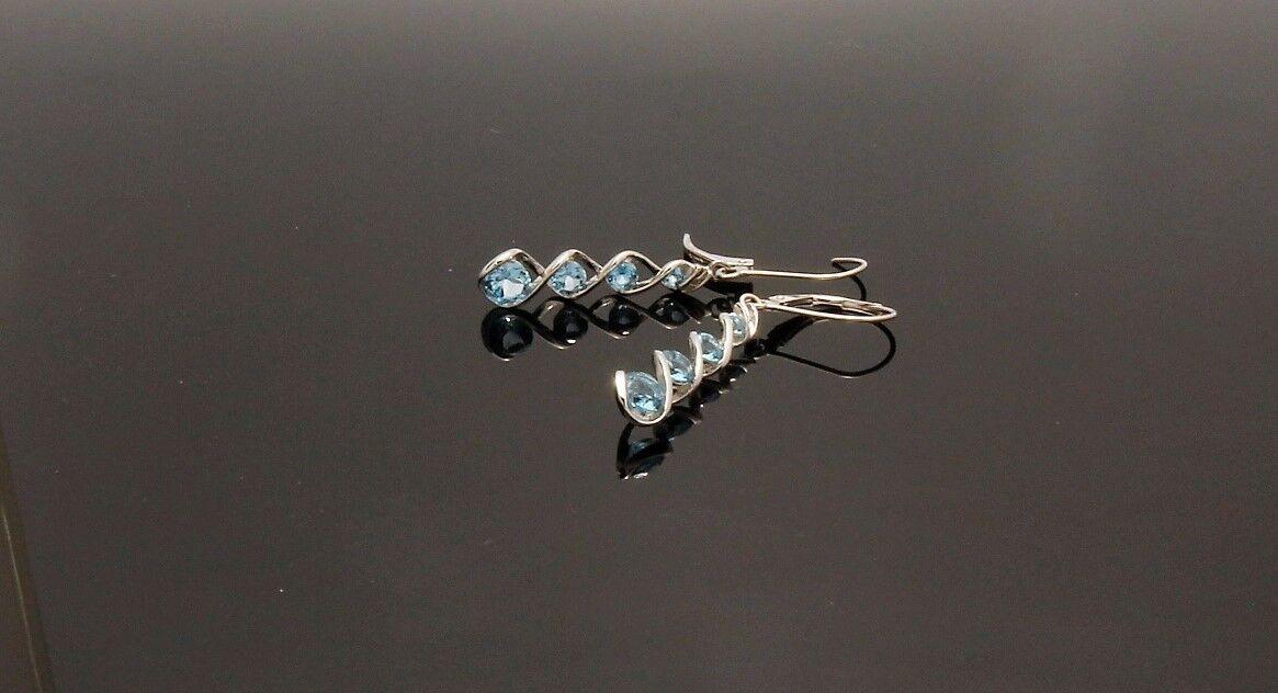 14Kt. White gold blueee Topaz Dangle Earrings
