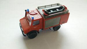 Roco-Unimog-Freiwillige-Feuerwehr-Buchenort-mit-Schlauchboot-Metz-Eigenbau-1-87