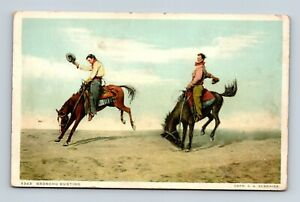 COWBOYS-WITH-HATS-IN-COWBOY-DRESS-034-BRONCHO-BUSTING-034-JUST-A-NICE-POSTCARD-A2