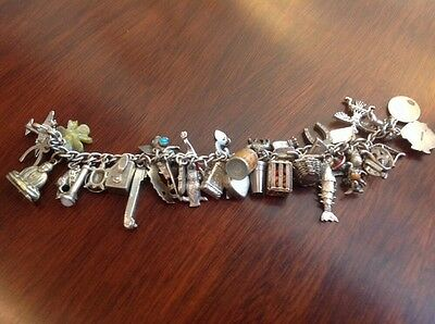 Vintage sterling silver travel bracelet loaded with 38 Rare charms
