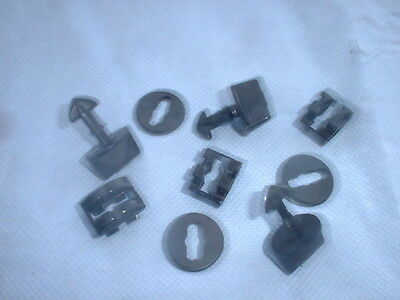 A SET OF THREE CLIPS AND TURN BUCKLES FOR WEATHER SHIELD.