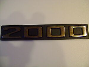 LOGO-ou-MONOGRAMME-2000-coloris-gris-et-noir-NEUF-autocollant