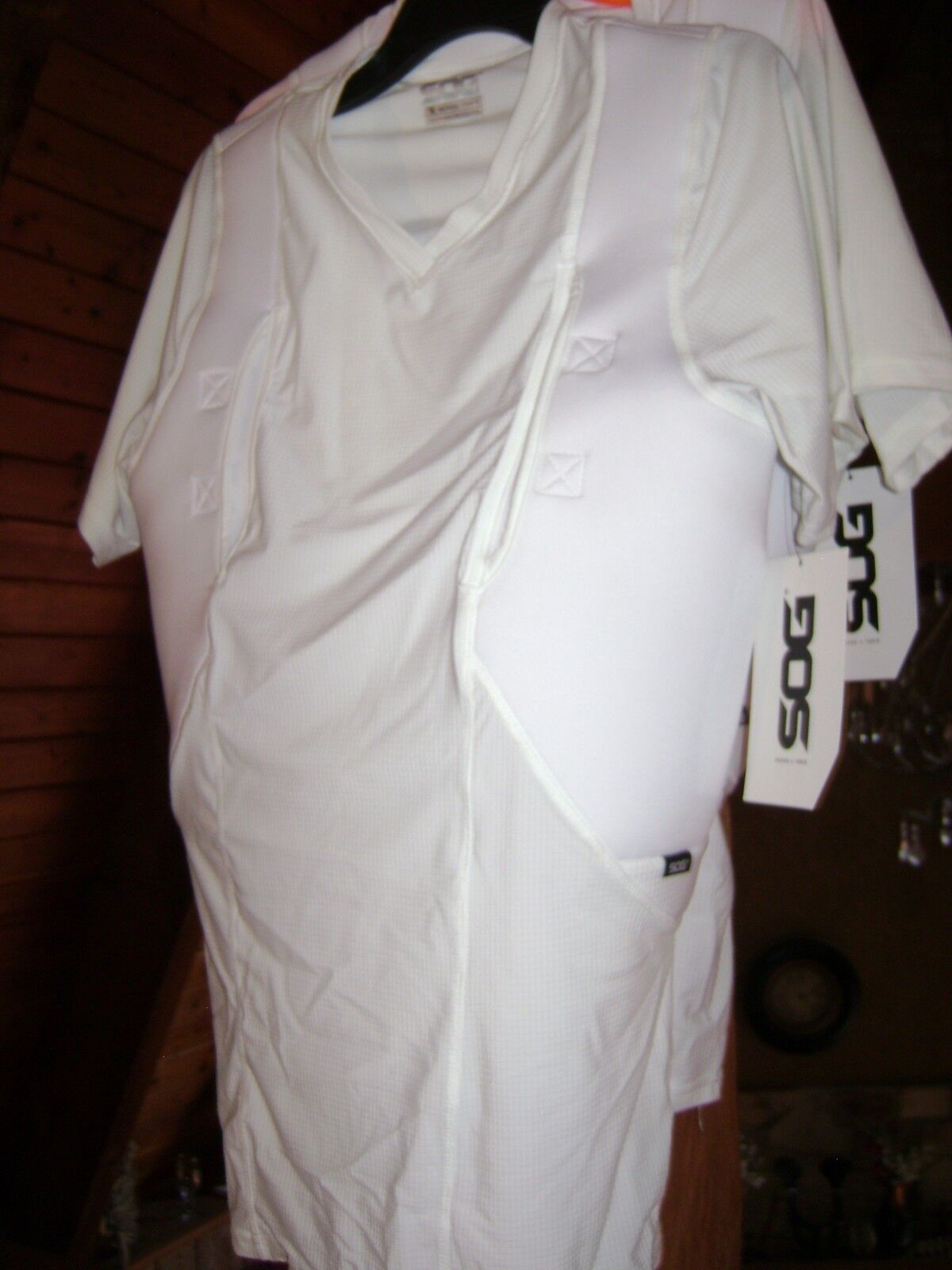 2sog   white sog tactical concealed weapon shirts, 1 lrg. 1 xlrg. both brand new   store sale outlet