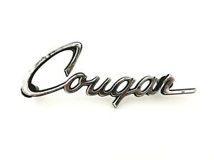 1970-1977 MERCURY COUGAR SIDE FENDER OEM EMBLEM BADGE SYMBOL LOGO SIGN (1975)