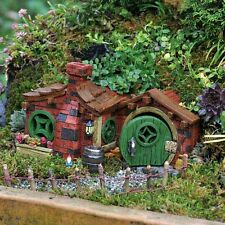 Beautiful green brick garden fairy house open door