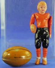 VINTAGE OCCUPIED CELLULOID FOOTBALL PLAYER AND TIN FOOTBALL CANDY CONTAINER