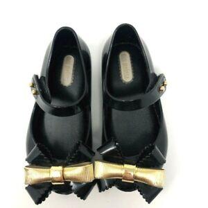Mini Melissa Girls Black Gold Bows