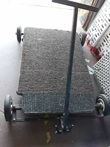 Skateboard-dolly-with-on-track-off-track-wheels
