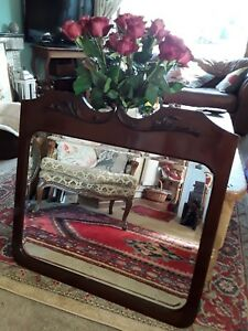 antique mahogany overmantle decorative bevelled aged mirror.  Delivery available