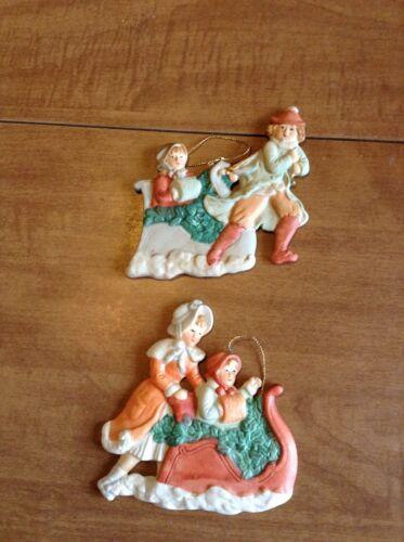 Set Of Two Handpainted Ardco Ceramic Children Sledding Ornaments