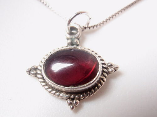 Small Oval Garnet Rope Style Accented 925 Sterling Silver Pendant