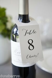 wedding reception party table numbers wine bottle neck labels tags