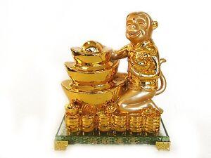 Golden-Monkey-Statue-with-Feng-Shui-Ingot
