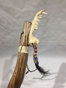 62-034-WOOD-WALKING-STICK-HAND-CARVED-WITH-ANIMAL-JAWBONE-HAIR-BEADS-AND-LEATHER
