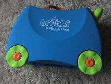 Trendy blue Melissa and Doug ride on or pull along Trunki suitcase for kids.