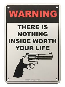 Metal-Sign-Warning-there-is-nothing-inside-worth-your-life