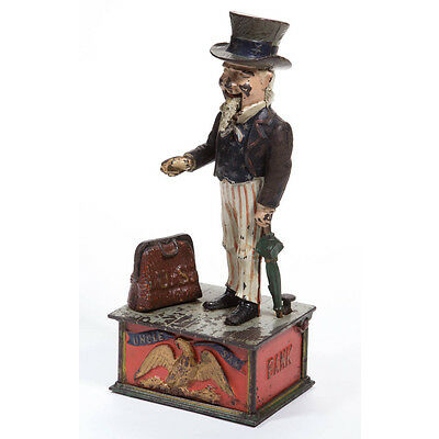 1003. UNCLE SAM CAST-IRON MECHANICAL BANK Lot 1003