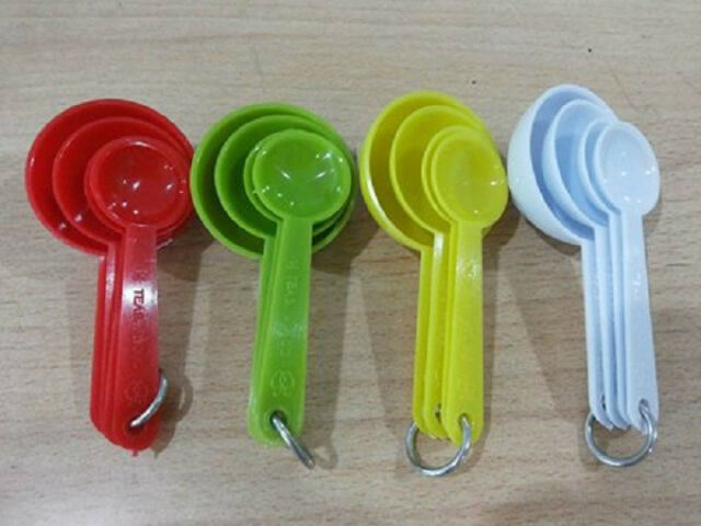 The Measuring Spoons And Cups Set With Ring Holders.